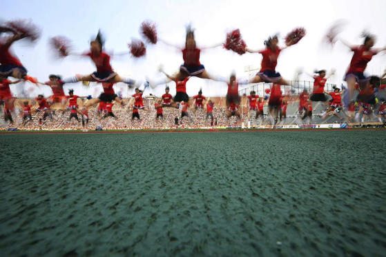 Slide 1 of 10: Cheerleaders perform before a rugby match between Japan and Hong Kong as past of 2014 ARFU Asian Five Nations at the National Stadium in Tokyo.
