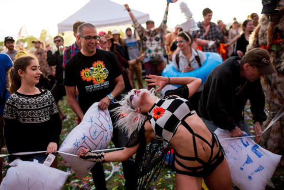 Slide 1 of 12: Super Geek League dancers interact with festival attendees on the third and final day of the annual Sasquatch music festival.