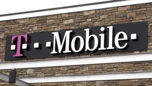 The T-Mobile store sign is seen in Broomfield, Colorado February 25, 2014. T-Mobile US Inc reported a bigger quarterly net loss, hurt by increased spending on promotions, and forecast higher capital spending for 2014.