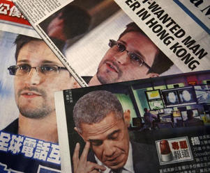 Photos of Edward Snowden, a contractor at the National Security Agency (NSA), and U.S. President Barack Obama are printed on the front pages of local English and Chinese newspapers in Hong Kong in this illustration photo June 11, 2013. Snowden, who leaked details of top-secret U.S. surveillance programs, dropped out of sight in Hong Kong on Monday ahead of a likely push by the U.S. government to have him sent back to the United States to face charges.: Photos of Snowden, a contractor at the NSA, and U.S. President Obama are printed on the front pages of local English and Chinese newspapers in Hong Kong in this illustration photo