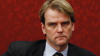 Canada's Parliamentary Secretary to the Minister of National Defence Chris Alexander listens during a news conference on Parliament Hill in Ottawa December 12, 2012. Canada scrapped a controversial sole-source plan to buy F-35 jets from Lockheed Mart