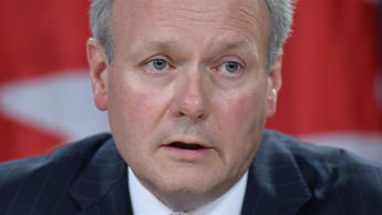 Bank of Canada governor Stephen Poloz speaks with media during a news conference, Thursday June 12, 2014 in Ottawa. THE CANADIAN PRESS/Adrian Wyld