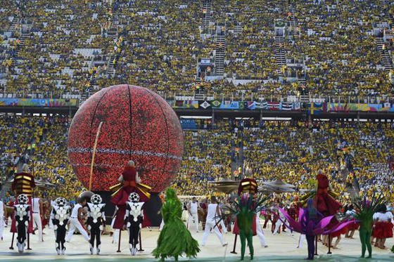 Slide 1 of 7: Performers participate in the opening ceremony of World Cup 2014 at the Corinthians arena in Sao Paulo, Brazil. Photo:AFP