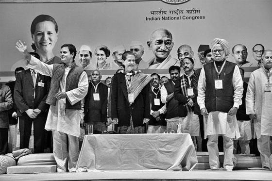 Slide 1 of 7: Scenes from the Congress meeting on 17 January. For half an hour, then PM Manmohan Singh's facial expression remains fixed—except once, when there is a hint of a smile as he is being garlanded along with Sonia Gandhi and Rahul Gandhi. Photo: Raghu Ra