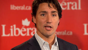 Liberal Leader Justin Trudeau talks with reporters at the end of the party's caucus retreat in Georgetown, P.E.I. on Thursday, Aug. 29, 2013.