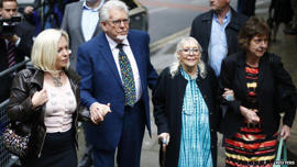 "Rolf Harris arriving at Southwark Crown Court with his family on 29 May 2014: Mr Harris has said his family accompany him into court ""to show support"""
