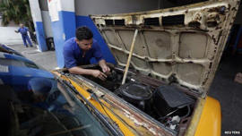 Cuban mechanic, April 14: The Cuban government says more than 450,000 people own or are employed by private businesses