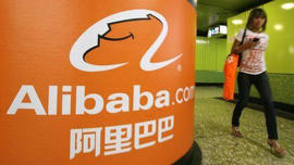 Alibaba.com logo and woman walking