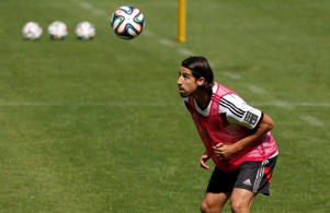 German national soccer player Sami Khedira heads a ball during a training session in St. Martin, northern Italy, May 28, 2014. The German national soccer team's training camp, in preparation for the 2014 World Cup in Brazil, began in St. Martin near Merano on May 21.: German national soccer player Khedira heads a ball during a training session in St. Martin