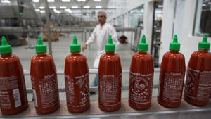 Bottles are produced for Sriracha Hot Chili Sauce at the Huy Fong Foods plant in Irwindale, California, on 14 May 2014