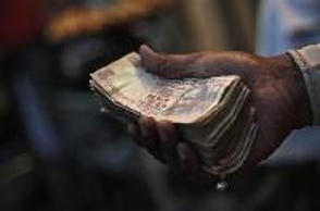 Rupee gains above 60/dollar, first time in eight months