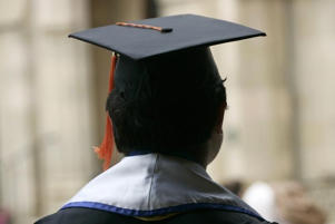 "An undocumented UCLA student attends a graduation ceremony for UCLA ""Dreamers"" or Dream Act students at a church near the campus in Los Angeles, California June 15, 2012."
