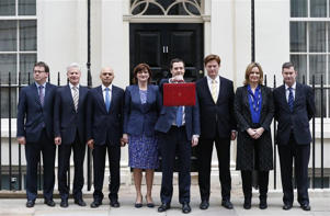 Britain's Chancellor of the Exchequer, George Osborne, holds up his budget case for the cameras as he stands with members of his Treasury team outside number 11 Downing Street, before delivering his budget to the House of Commons (Britain's Chancellor of the Exchequer, George Osborne, holds up his budget case for the cameras as he stands with members of his Treasury team outside number 11 Downing Street, before delivering his budget to the House of Commons © Reuters)