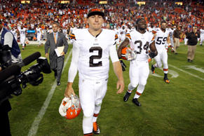 Cleveland Browns quarterback Johnny Manziel walks on the field after an NFL preseason football game against the Washington Redskins Monday, Aug. 18, 2014, in Landover, Md.