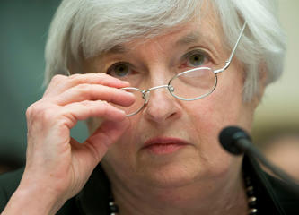 In this July 16, 2014, photo,  Federal Reserve Chair Janet Yellen removes her glasses as she testifies on Capitol Hill in Washington.