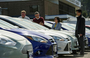 Customers shop for cars at the Serramonte Ford Motor Co. dealership in Colma, California, U.S., on Friday, March 29, 2013.