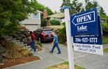 Potential home buyers arrive to an open house in Seattle, Washington, U.S., on Sunday, July 20, 2014. Sales of previously owned U.S. homes climbed in June to an eight-month high as more listings helped prices cool, luring buyers into the market.