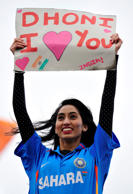 An Indian cricket fan holds a banner reading 'Dhoni I [love] you' referring to Indian captain Mahendra Dhoni during the 2013 ICC Champions Trophy cricket match between Pakistan and India at Edgbaston in Birmingham, England on June 15, 2013.