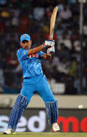 India's captain M.S Dhoni plays a ball against Australia during their ICC Twenty20 World Cup match at the Sher-E-Bangla National Cricket Stadium in Dhaka March 30, 2014.