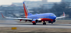 A Southwest Airlines jet plane lands at Love Field in Dallas.