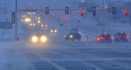 Early morning motorists on 1-8 in Bismarck, N.D., face treacherous driving conditions Thursday, Jan. 8, 2015, with strong winds and blowing snow reducing visibility as a winter weather advisory was extended into central North Dakota.