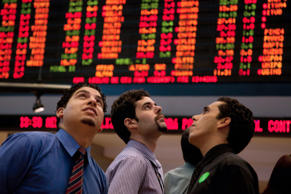 Investors look at the electronic displays at the Stock Exchange (Bovespa) in Sao Paulo, Brazil.