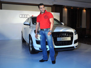 Indian Bollywood actor Salman Khan poses next to an Audio Q7 German luxury car gifted for the success of the Bollywood Hindi film 'Bodyguard' in Mumbai on December 7, 2011.