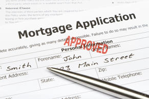 Close-up of an Approved Mortgage application with Pen