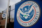 The U.S. Department of Homeland Security (DHS) seal stands at the agency's headquarters in Washington, D.C. on Thursday, Dec. 11, 2014.