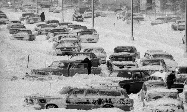 Slide 1 of 11: The Van Wyck Expressway near Kennedy Airport looks like a huge parking lot instead of a highway as stranded cars remain stuck in the big snow