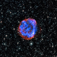 In this image, an expanding shell of debris called SNR 0519-69.0 is left behind after a massive star exploded in the Large Magellanic Cloud, a satellite galaxy to the Milky Way. Multimillion degree gas is seen in X-rays from Chandra, in blue. The outer edge of the explosion (red) and stars in the field of view are seen in visible light from the Hubble Space Telescope.