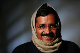 Delhi's Chief Minister Arvind Kejriwal, Chief of the Aam Aadmi (Common Man) Party (AAP), smiles during an interview with Reuters at his residence on the outskirts of New Delhi in this January 27, 2014 file photo.