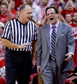 Indiana coach Tom Crean (right) disputes a call with official Tim Clougherty during a game against Wisconsin on Feb. 3, 2015, in Madison, Wis. Wisconsin won 92-78.