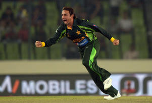 Pakistani  bowler Saeed Ajmal celebrates after taking the wicket of Sri Lankan batsman Kumar Sangakkara during the final match of the Asia Cup one-day cricket tournament between Pakistan and Sri Lanka at the Sher-e-Bangla National Cricket Stadium in Dhaka on March 8, 2014.