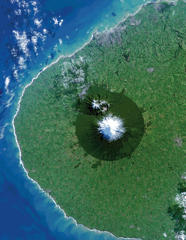 Egmont National Park in New Zealand is photographed from space. Mt. Taranaki is at the center of the image. This isolated island of protected forest (dark green area) is surrounded by once-forested pasturelands.
