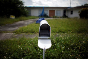 An empty mail box is seen at the front door of a foreclosed house in Miami Gardens, Florida in this September 15, 2009 file photo. There are more than 6,600 home foreclosure filings per day, according to the Center for Responsible Lending, a nonpartisan watchdog group based in Durham, North Carolina. With nearly two million already this year, the flood of foreclosures shows no sign of abating any time soon.