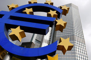 A euro logo sculpture stands in front the headquarters of the European Central Bank (ECB) in Frankfurt October 26, 2014.