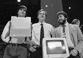 Steve Jobs, left, chairman of Apple Computers, John Sculley, centre, president and CEO, and Steve Wozniak, co-founder of Apple, unveil the new Apple IIc computer in San Francisco, Calif., April 24, 1984.