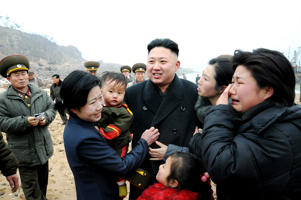 Residents greet North Korean leader Kim Jong-Un (C) during his visit to the Jangjae Islet Defence Detachment and Mu Islet Hero Defence Detachment on the front, near the border with South Korea, southwest of Pyongyang March 7, 2013 in this picture released by the North's official KCNA news agency in Pyongyang March 8, 2013.