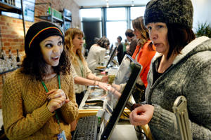 Budtender Miriam Howes, left, talks about edibles with customer, Kelly Keckner, at LivWell Broadway in Denver, CO, January 29, 2015. The dispensary has all recreational edibles on a 40 percent off sale because of looming state regulations that come into effect on Feb. 1 that will make some of those products non-compliant with Colorado law.