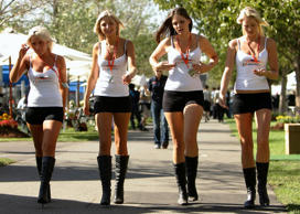 Pit girls smile walk through the paddock ahead of the Australian Formula One Grand Prix at the Albert Park Circuit on March 15, 2007 in Melbourne, Australia.