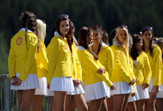 Grid girls line up in the paddock during the qualifying session at the Spa-Francorchamps circuit on September 1, 2012 in Spa ahead of the Belgium Formula One Grand Prix.