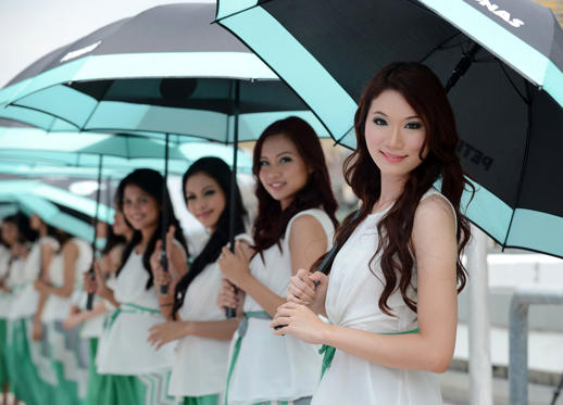Grid girls line up before the start of the Formula One Malaysian Grand Prix in Sepang on March 24, 2013.