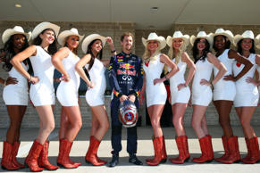 Sebastian Vettel of Germany and Infiniti Red Bull Racing poses with grid girls before the United States Formula One Grand Prix at Circuit of The Americas on November 2, 2014 in Austin, United States.