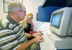 Dane Nagel, left, starts a data entry skill test as Senior Personnel Supervisor Audrey Ealem observes, Thursday, December 28, 2006 at David Wood Personnel in West Palm Beach, Florida. The number of Americans filing first-time claims for unemployment benefits edged higher last week, while staying at a level consistent with a healthy labor market, according to the Labor Department.