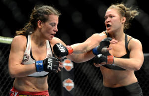 Ronda Rousey, right, and Miesha Tate fight during their UFC women's bantamweight championship bout at the MGM Grand Garden Arena on Dec. 28, 2013.