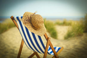 Sun hat on chair on beach