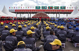 Ethiopian and Chinese workers of the China Communication Construction Company sit at the site of the Addis Ababa-Adama toll road on May 5, 2014. The site was christened by Chinese Prime Minister Li Keqiang. Li arrived in Ethiopia for the start of a four-nation African tour, his first visit to the continent since assuming his position a little over a year ago.