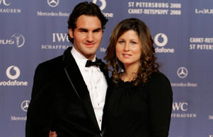 Switzerland's tennis player Roger Federer, left, and his partner Mirka arrive for the Laureus Sports Awards in St. Petersburg, Russia, Monday, Feb. 18, 2008. Feder was awarded as Laureus World Sportsman of the Year.