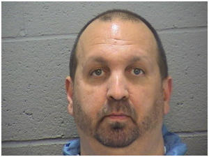 This image provided by the Durham County Sheriff's office shows a booking photo of Craig Stephen Hicks, 46, who was arrested on three counts of murder early Wednesday Feb. 11, 2015. Police were responding to a report of gunshots around 5:15 p.m. Tuesday when they found three people who were pronounced dead at the scene. The dead were identified as Deah Shaddy Barakat, 23, of Chapel Hill; Yusor Mohammad, 21, of Chapel Hill; and Razan Mohammad Abu-Salha, 19, of Raleigh.